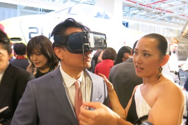 """Guests watch a short Virtual Reality segment of """"Rise Above"""", a video about survivors, who have participated in Womankind Programs."""